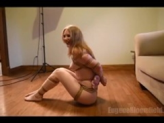 Well tied up girl struggles to stand up