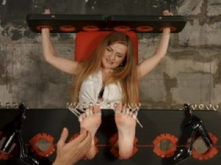 Tickling bare feet in stocks