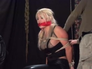 Busty blonde military girl gagged and tied on the floor