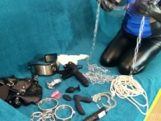 Long ASMR Mistress in leather leggings is choosing devices for her slave