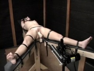 PERFECT CHAINED BABE WITH SHAVED PUSSY GETS DRILLED BY MACHINE
