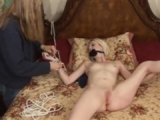 Cute blonde tricked in bdsm shoot