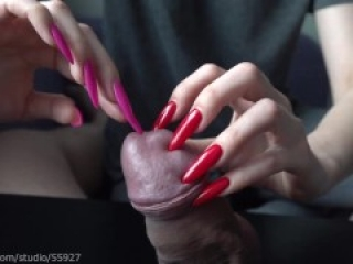 Long red nails play with peehole