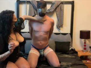 Sub handcuffed and panty gagged with duct tape brought to orgasm