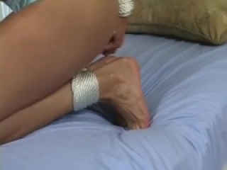 sexy girl hogtied, toetied and tape gagged