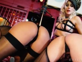 Blonde mistress in thigh high boots uses her two slaves