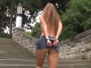 Nadine topless self handcuffed behind her back in a public place and walkes
