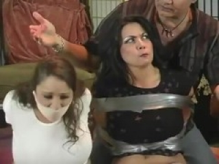 Two girls are wrap gagged and tormented