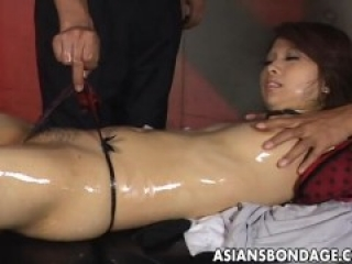 Japanese brunette tied up and tormented