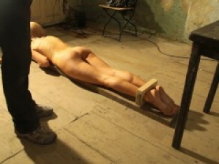 Test of torture instruments on a naked slave