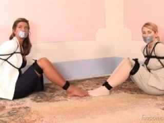 Two women tape gagged