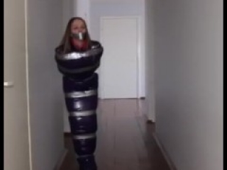 Taped up girl hops around