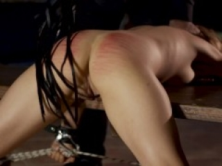 Obedient slave with legs and arms tied up